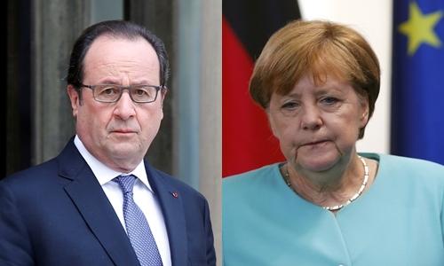 Tổng thống Pháp Francois Hollande (trái) và Thủ tướng Đức Angela Merkel. Ảnh: Reuters.