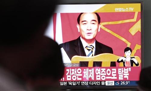 Hình ảnh Thae Yong-ho, phó đại sứ Triều Tiên tại Anh đào tẩu, xuất hiện trên truyền hình Hàn Quốc. Ảnh: AP.