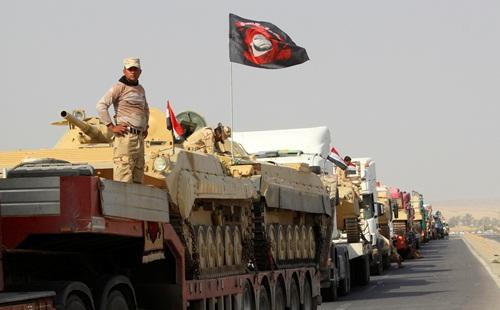 Lực lượng Iraq hôm 12/10 tại ngoại ô Mosul, chuẩn bị tấn công IS. Ảnh: Reuters