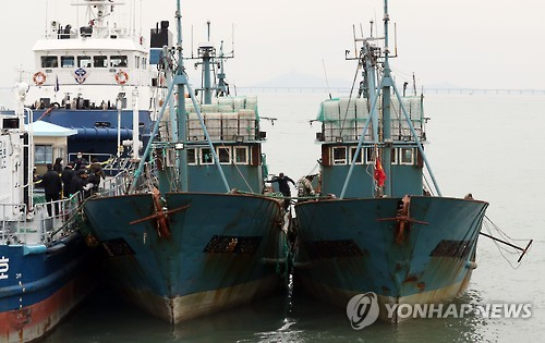Two Chinese fishing boats, which were seized while illegally fishing in South Korean waters in the West Sea, arrive in the port of Incheon, west of Seoul, on Nov. 2, 2016. South Koreas Coast Guard fired warning shots with an M60 machine gun to capture the vessels earlier in the day.