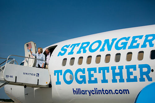 Hillary Clinton and Senator Tim Kaine of Virginia on the campaigns new charter plane on Monday in Cleveland.