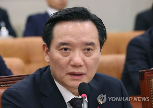 Justice Minister Kim Hyun-woong speaking during a parliamentary session at the National Assembly in Seoul.