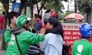 Cảnh sát nổ súng trấn áp GrabBike và xe ôm hỗn chiến ở Sài Gòn