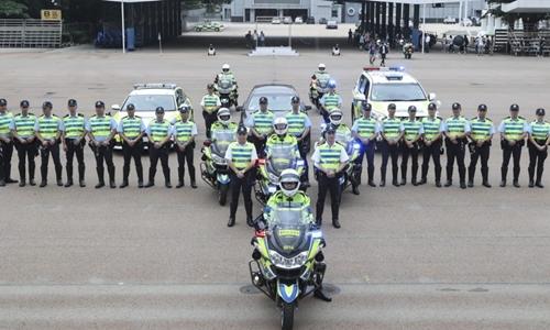 Lực lượng hộ tống yếu nhân của cảnh sát Hong Kong. Ảnh: SCMP.