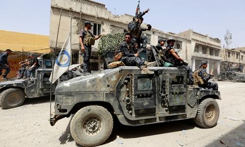 Cảnh sát liên bang Iraq trong chiến dịch giải phóng Mosul. Ảnh: Reuters.