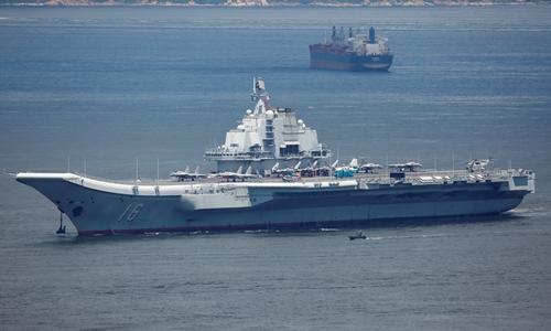 Tàu sân bay Liêu Ninh rời Hong Kong ngày 11/7. Ảnh: Reuters.